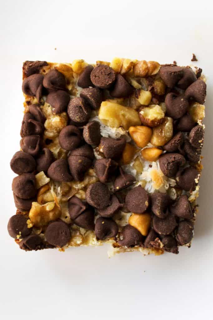 Magic Bars | Magic Bars are the perfect combination of chocolate, coconut, nuts and butterscotch to make this the best gooey, sweet treat of the holiday season. | Pack Momma | www.packmomma.com