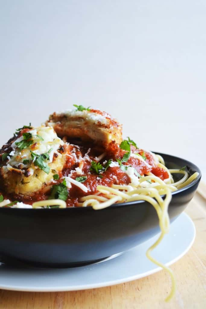 Easy Baked Chicken Parmesan | Easy Baked Chicken Parmesan is crunchy on the outside and moist and tender on the inside. The perfect quick and easy meal for any day of the week. | Pack Momma | https://www.packmomma.com