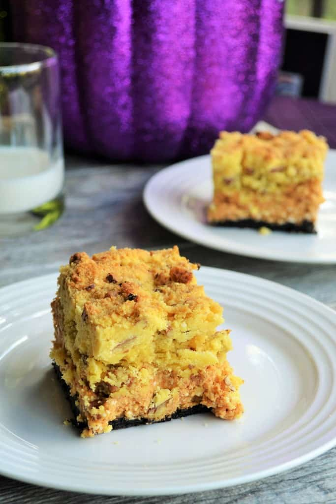Pumpkin Cheese Crunch Bars | These Pumpkin Cheesecake Crunch Bars are the perfect combination of creamy cheesecake and crunchy topping. A MUST HAVE recipe for fall. | Pack Momma | https://www.packmomma.com