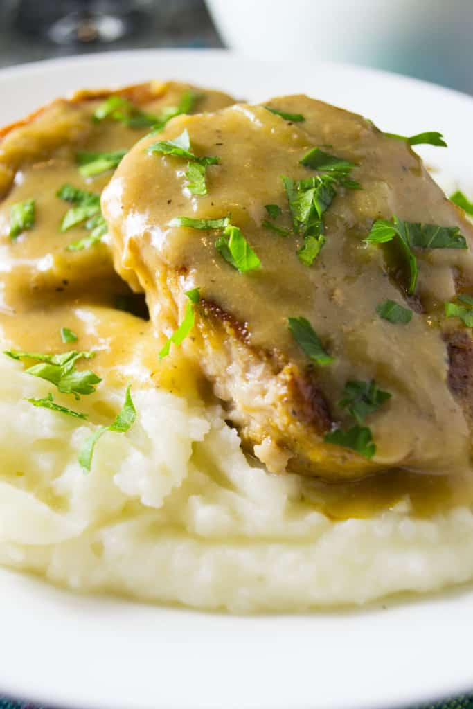 Smothered Slow Cooker Pork Chops - Pack Momma