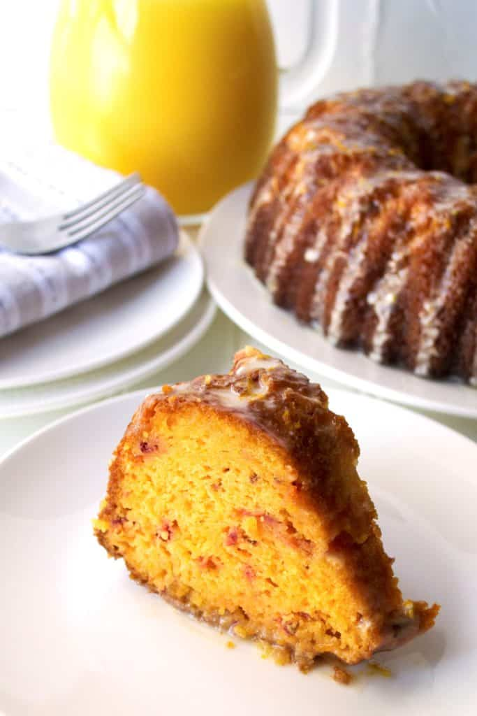 Cranberry Orange Cake | Cranberry Orange Cake is moist and packed with orange cranberry flavor. A perfect sweet treat to serve up for either a special breakfast or a tasty dessert. | Pack Momma | www.packmomma.com
