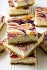 Red White and Blue Cheesecake Bars | Red White and Blue Cheesecake Bars are the perfect sweet treat to celebrate Fourth of July and to share with family and friends this summer. | Pack Momma | https://www.packmomma.com