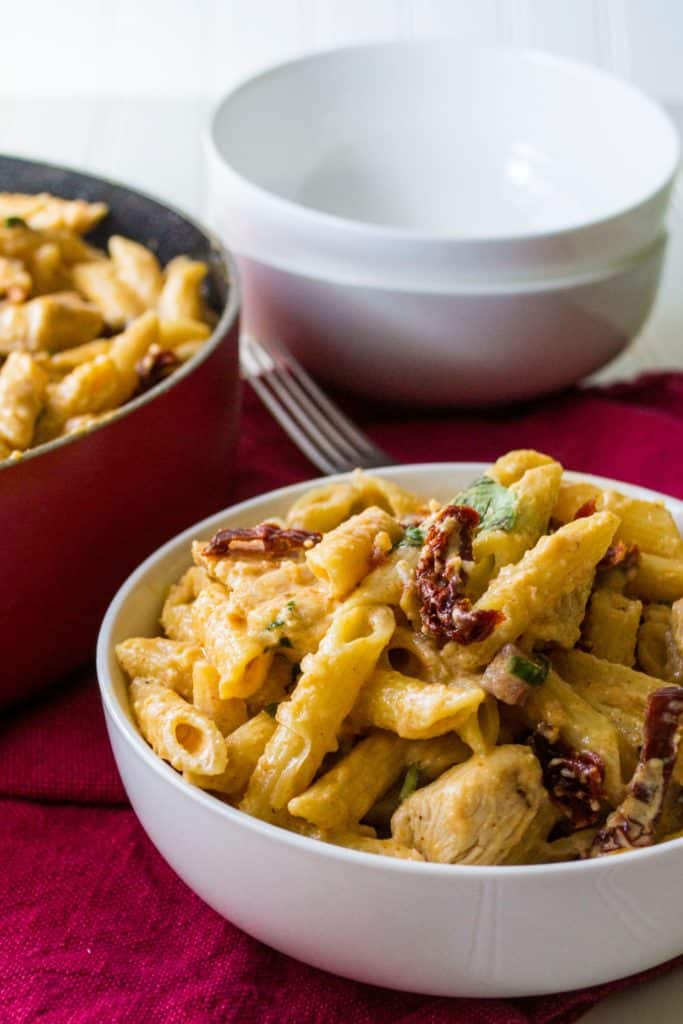 Tuscan Chicken Pasta | Tuscan Chicken Pasta is cheesy, creamy and a little spicy with hearty chicken and pasta mixed with sun dried tomatoes and panchetta. The perfect quick meal! | Pack Momma | www.packmomma.com