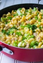 One Pot Cheesy Chicken Pasta | One Pot Cheesy Chicken Pasta is a hearty meal that's on your table in 30 minutes. Tender chicken, pasta, cheese and broccoli make this the perfect dinner. | Pack Momma | www.packmomma.com