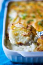 Cheesy Scalloped Potatoes | Cheesy Scalloped Potatoes is the ultimate side dish of perfectly cooked potatoes in a rich sharp cheese sauce and baked crisp in the oven. Irresistible! | Pack Momma | https://www.packmomma.com