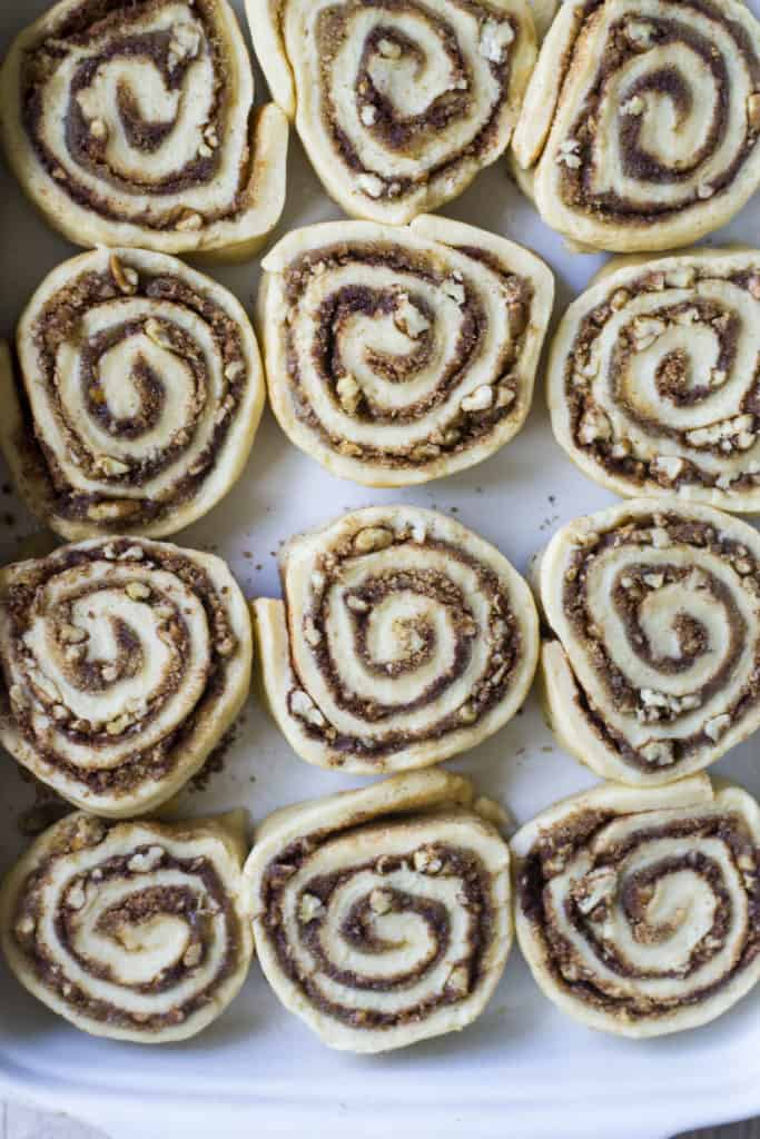 Pecan Rolls cut into slices and uncooked in a baking pan