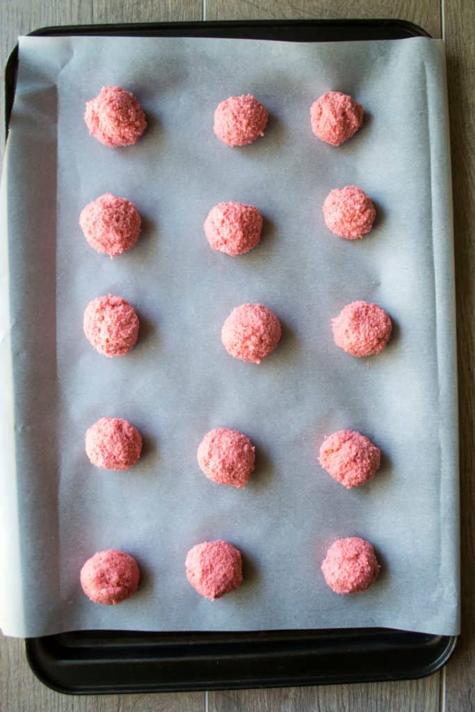 Champagne Cake Pops rolled into balls and set on a baking sheet