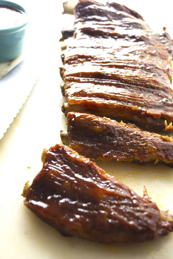Spicy Asian BBQ Ribs | These oven baked Spicy Asian BBQ Ribs are smothered in a spicy sweet Asian inspired sauce that will have you licking your fingers and reaching for more. | Pack Momma | www.packmomma.com