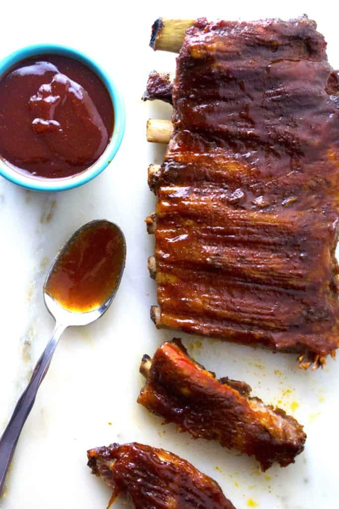 Spicy Asian BBQ Ribs | These oven baked Spicy Asian BBQ Ribs are smothered in a spicy sweet Asian inspired sauce that will have you licking your fingers and reaching for more. | Pack Momma | https://www.packmomma.com