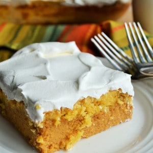 Pumpkin Crunch Cake | Pumpkin Crunch Cake is creamy pumpkin filling topped with a buttery, crunchy topping and covered in layers of sweet whipped topping. Perfection! | Pack Momma | https://www.packmomma.com