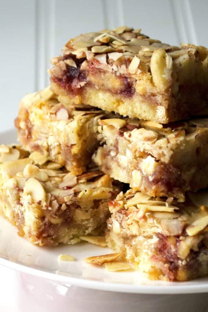 Raspberry Almond Bars | Raspberry Almond Bars are tart, sweet and packed with almond flavor. These are an easy crowd pleasing dessert treat that is sure to be your new favorite. | Pack Momma | https://www.packmomma.com
