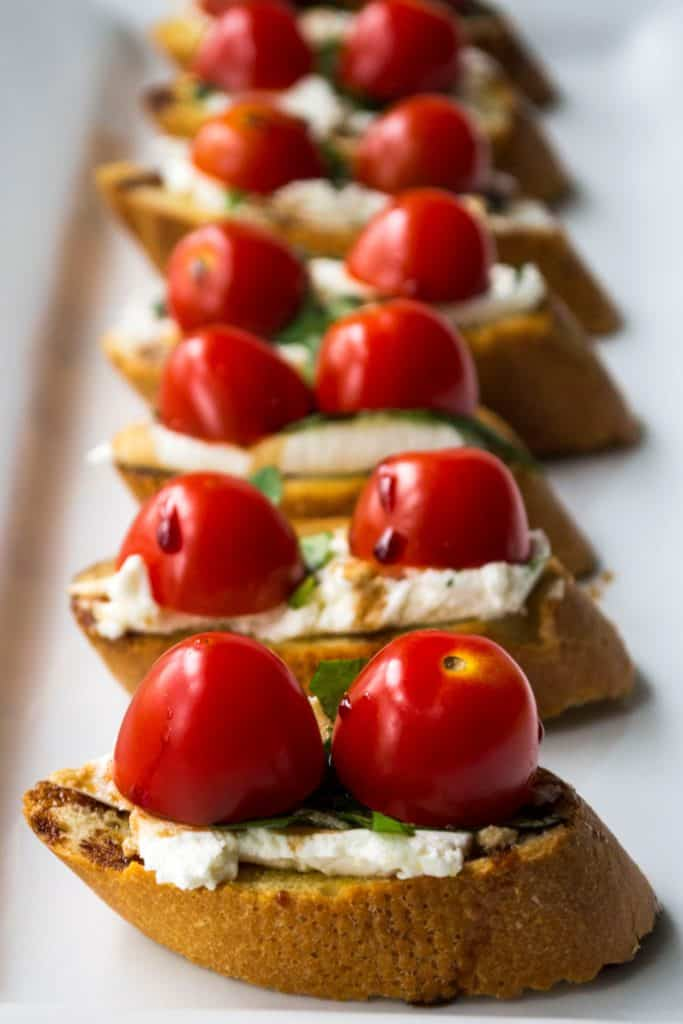 Goat Cheese Bruschetta | Goat Cheese Bruschetta is the perfect appetizer to serve at every party. Toasted bread topped with goat cheese, basil, tomatoes and balsamic glaze. Perfect! | Pack Momma | https://www.packmomma.com