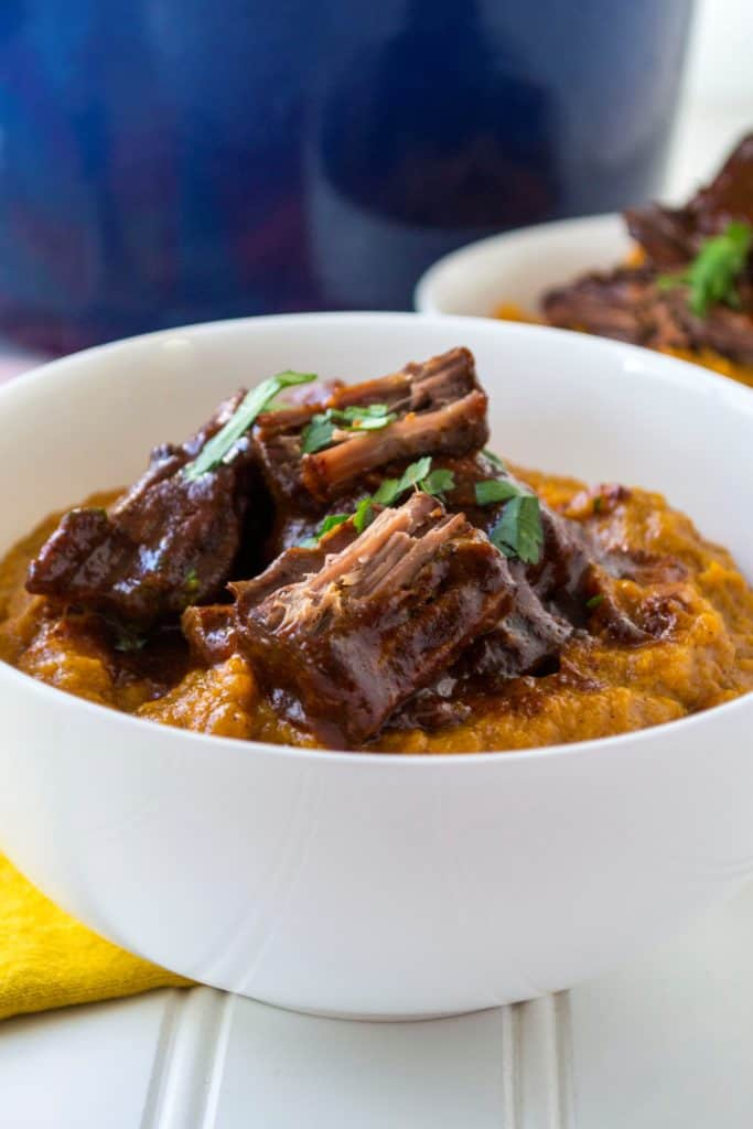 Red Chile Sauce Braised Beef | Red Chile Sauce Braised Beef is tender braised beef swimming in a spicy red chile sauce that is the perfect combination of heat and delicious flavor. | Pack Momma | https://www.packmomma.com