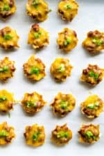 Chili Cheese Dip Bites  Chili Cheese Dip Bites combine spicy chili, melted cheddar cheese and cream cheese and deliver it in individual little nacho chips. Perfect for Game Day!   Pack Momma   www.packmomma.com